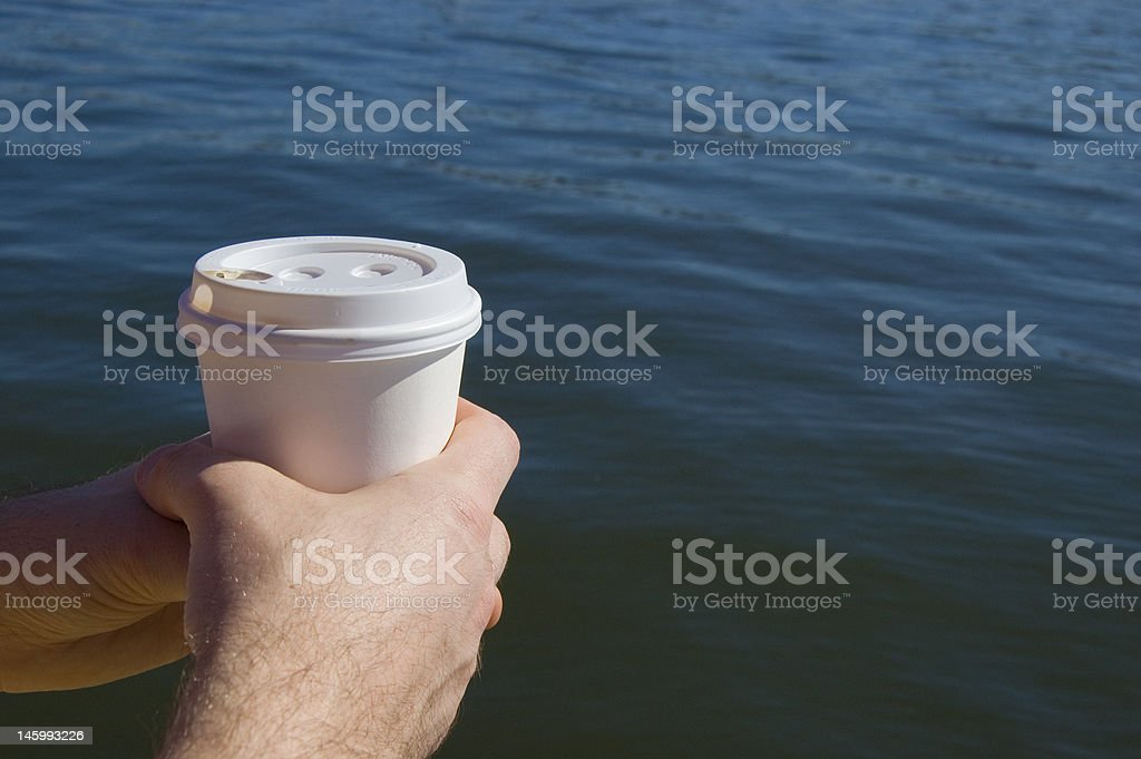 Take away coffee at the water front royalty-free stock photo