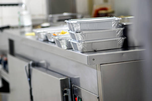 Take away  food in foil boxes in Chinese restaurant kitchen Take away  food in foil boxes in Chinese restaurant kitchen food state stock pictures, royalty-free photos & images