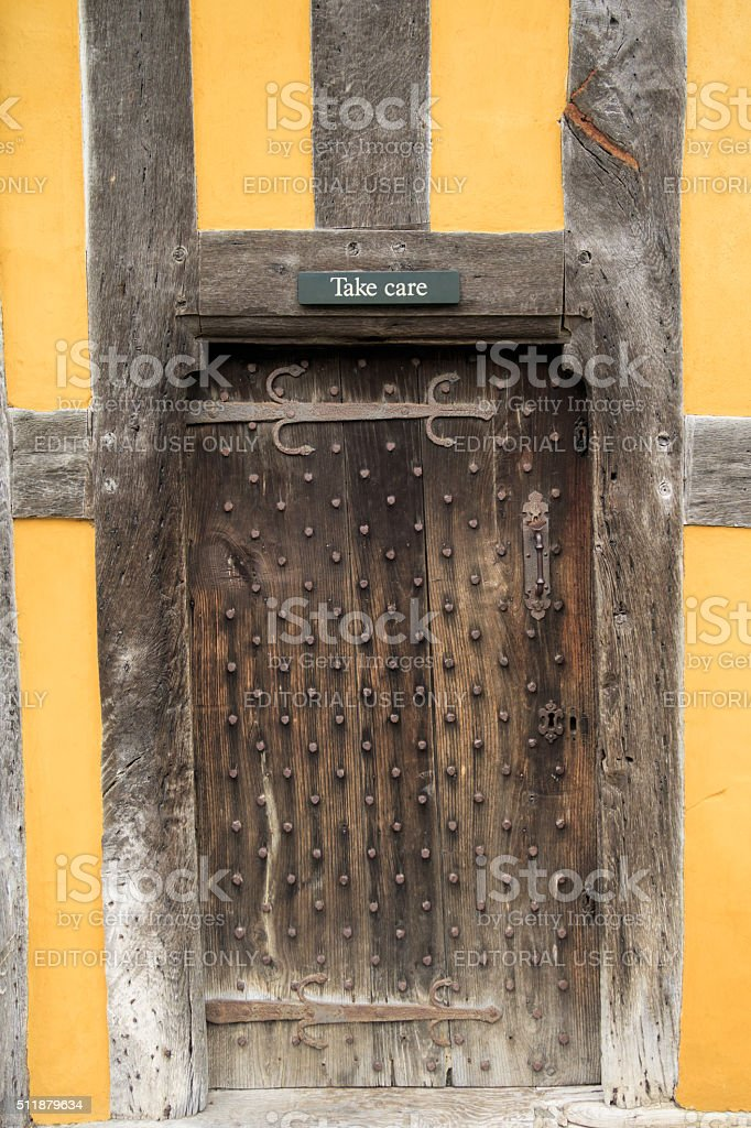 STOKE'Take Care' sign above a door at Stokesay Castle. stock photo