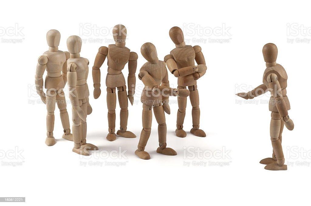 Take it easy - wooden mannequin team in discussion royalty-free stock photo