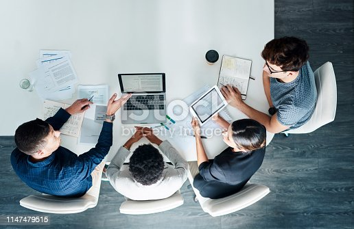 High angle shot of a group of businesspeople having a meeting in a modern office