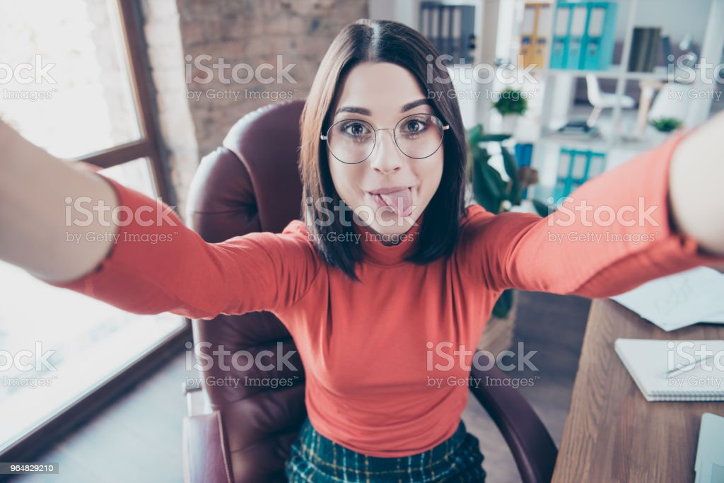 Take make employment education interior workplace agent happiness video call internet connection new job social network people person concept. Close up of lovely comic secretary sitting on armchair royalty-free stock photo