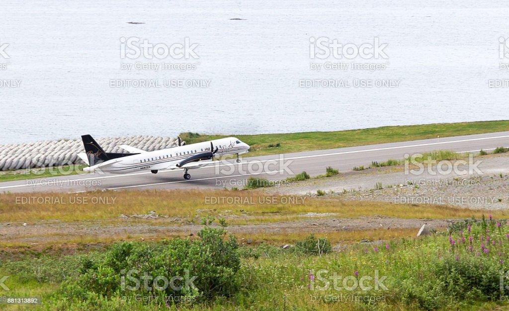 Take off of A SAAB 2000s aircraft of Pen Air at Tom Madsen, Dutch Harbor, Unalaska. stock photo