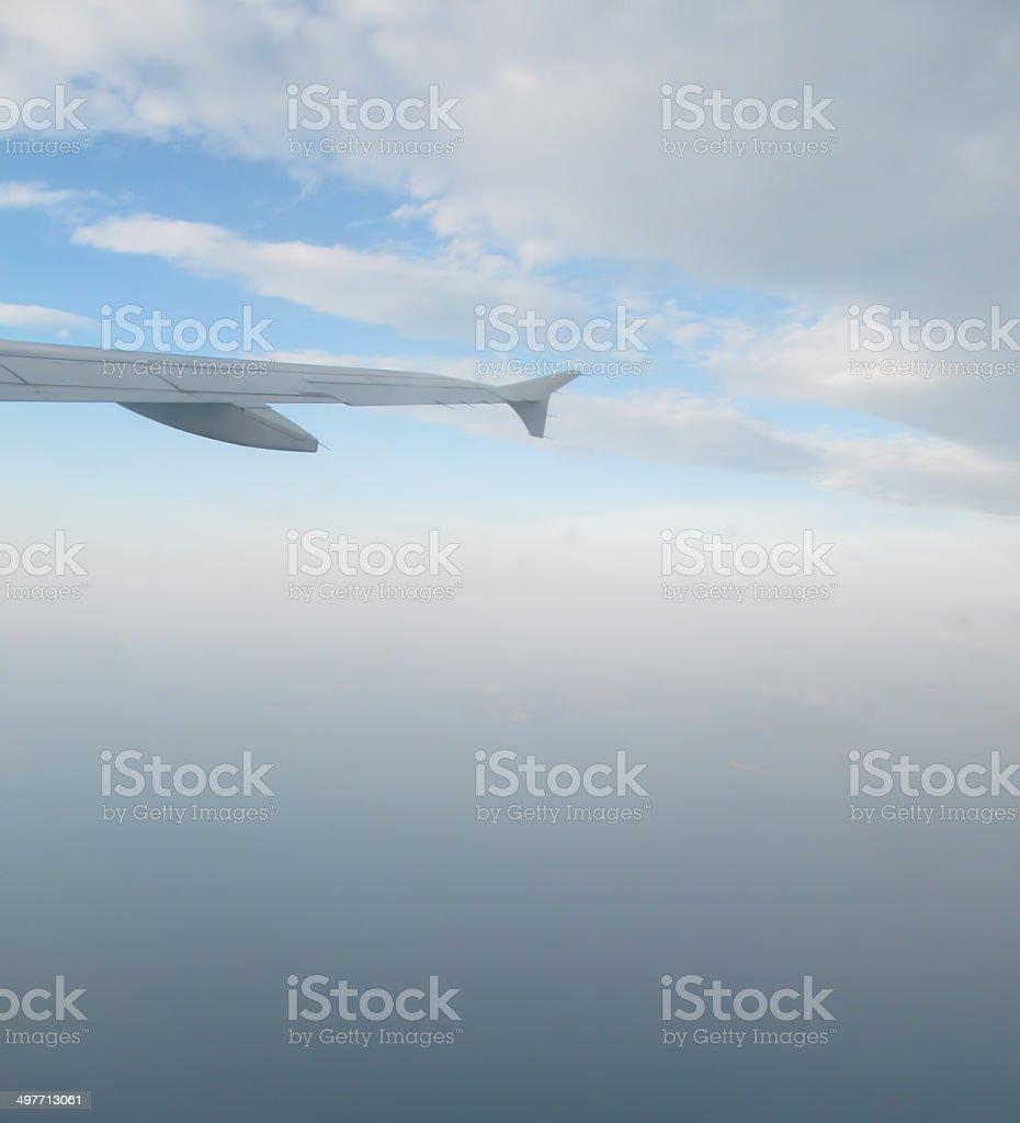 take off over blue sea stock photo