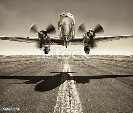 picture of an old airplane while take off