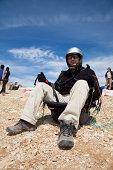 """Antalya, Turkey - April 24, 2010: Adventurer a tourist waiting  paragliding in Fethiye."""
