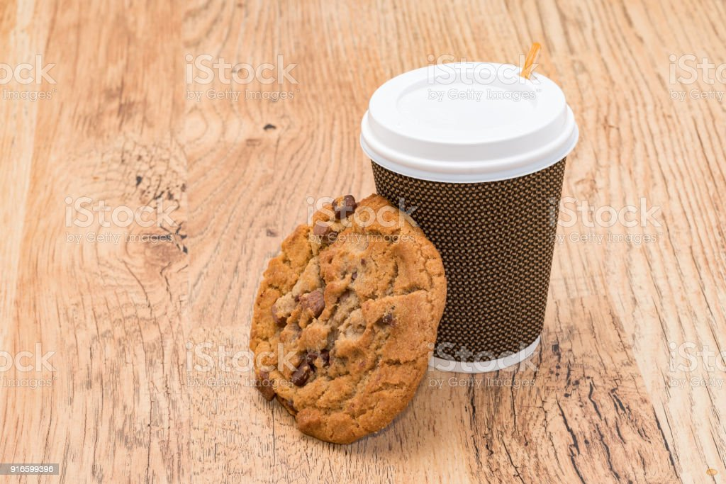 Take out coffee and a cookie biscuit stock photo