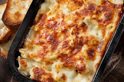 Take Out Creamy Chicken Alfredo Lasagna with Garlic Bread