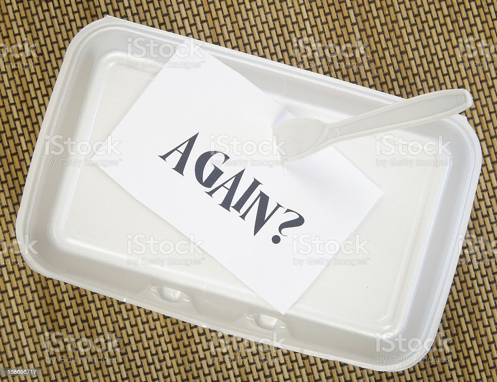 Take out food container with 'Again?' stuck on top royalty-free stock photo