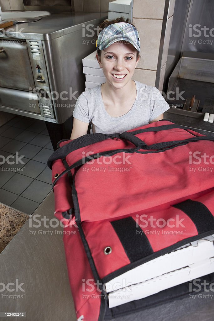 Take Out Waitress at Pizza Restaurant royalty-free stock photo