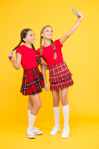 istock Take perfect photo. Girls just want to have fun. Schoolgirls use mobile phone smartphone taking photo. Selfie photo for social networks. Born to be internet superstar. Girls take selfie smartphone 1267169976