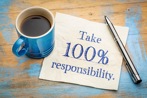 Take responsibility reminder note on napkin