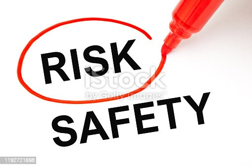 Concept about choosing to take a Risk instead of Safety. Word Risk picked with red marker over the word Safety.