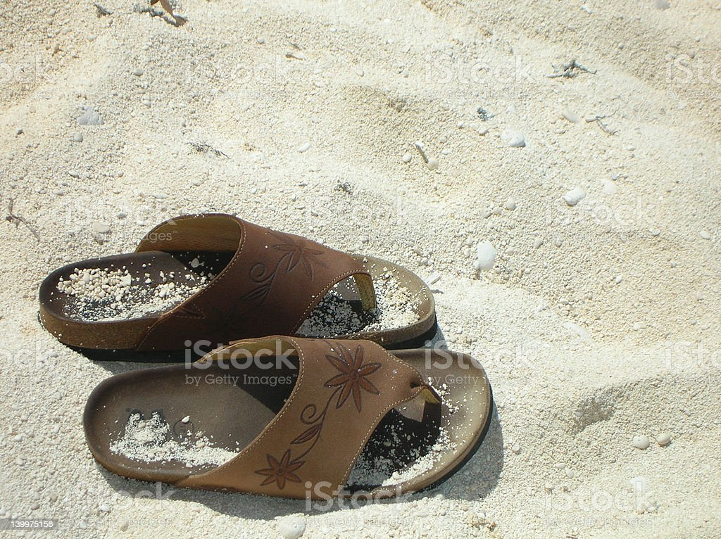 Take some time off - Sandals on the beach royalty-free stock photo