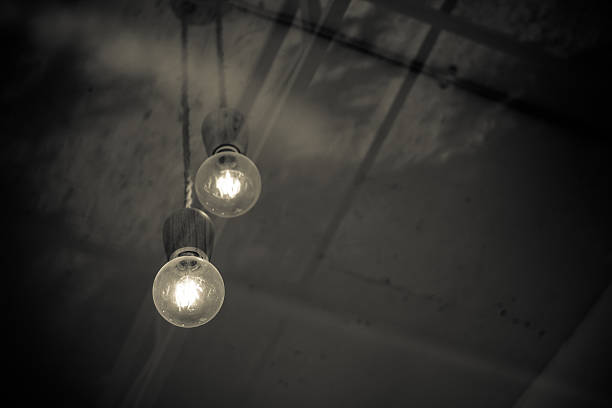 take the bulb in the coffee shop through glass - dimly stock pictures, royalty-free photos & images
