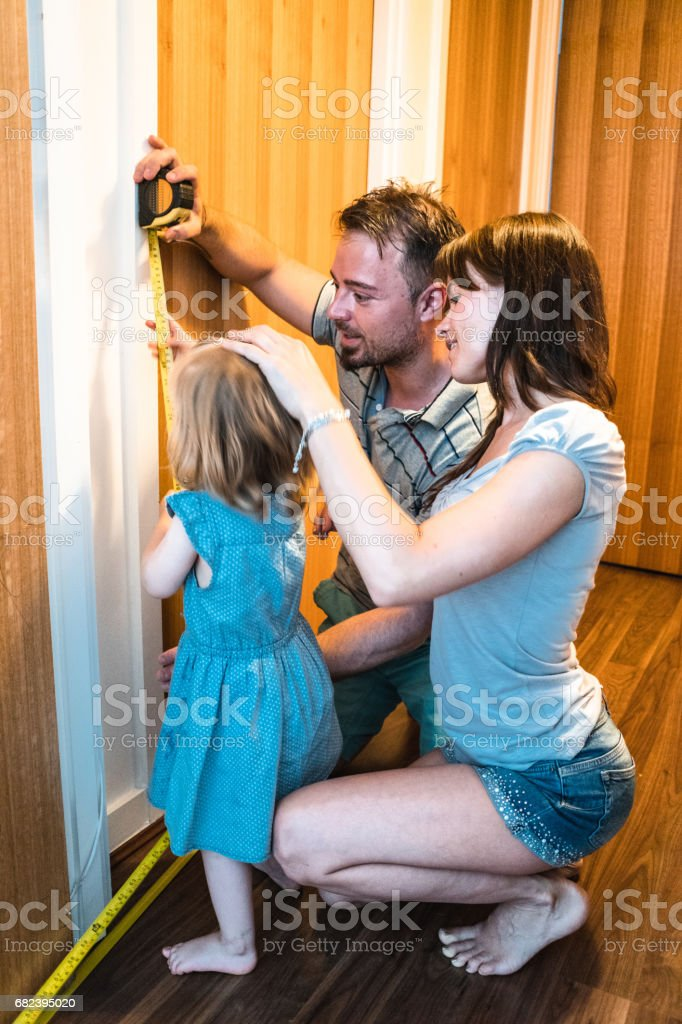 take the height of the daughter royalty-free stock photo