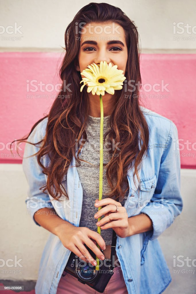 Take the time to smell the flowers and enjoy life royalty-free stock photo