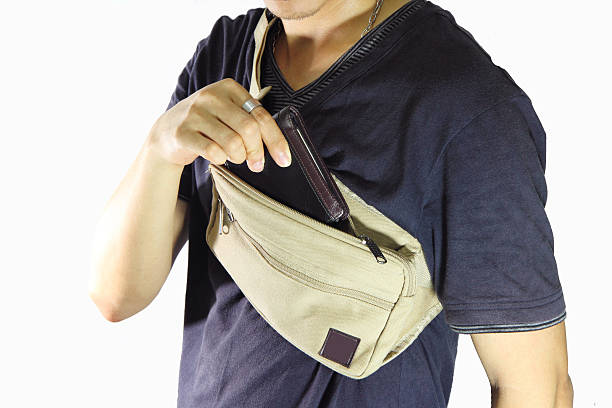 take the wallet  from waist belt bag - waist bag stock photos and pictures