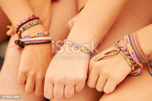 Cropped shot of teenage friends wearing friendship bracelets