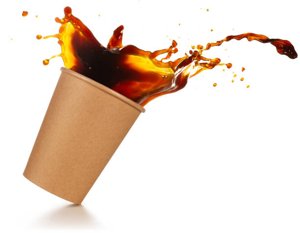 take-away coffee splashing coffee splashing out of a take-out cup tilted on white background spilling stock pictures, royalty-free photos & images