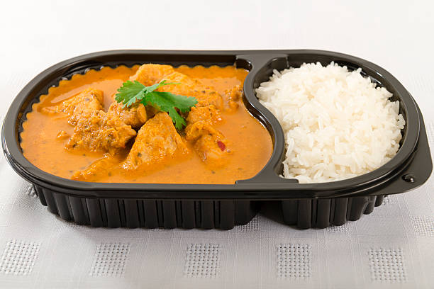 takeaway curry - gemaksvoedsel stockfoto's en -beelden