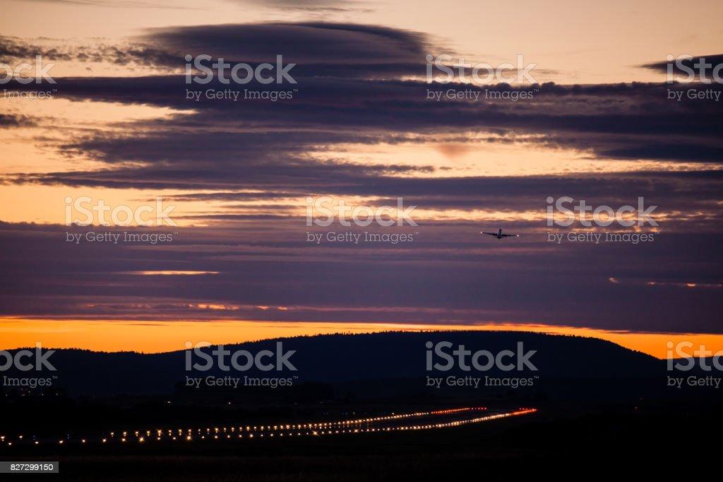 Takeoff at sunset stock photo