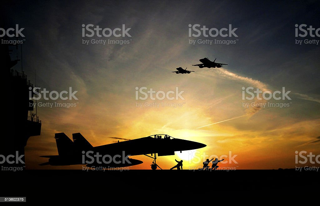 Take-off Military aircraft before take-off from aircraft carrier on sunset background Adult Stock Photo