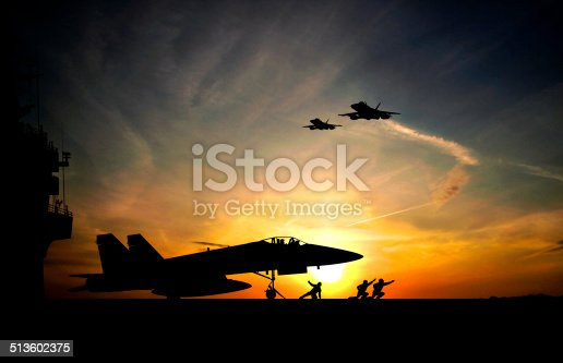 Military aircraft before take-off from aircraft carrier on sunset background
