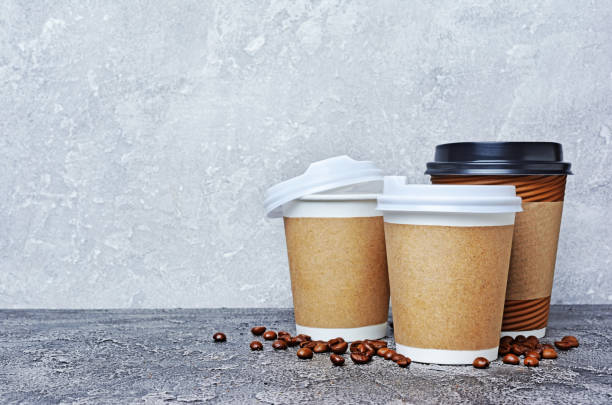 Take-out blank paper brown coffee cups stock photo