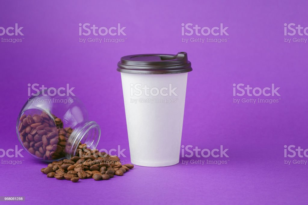 Take-out coffee in closed paper cup with beans stock photo