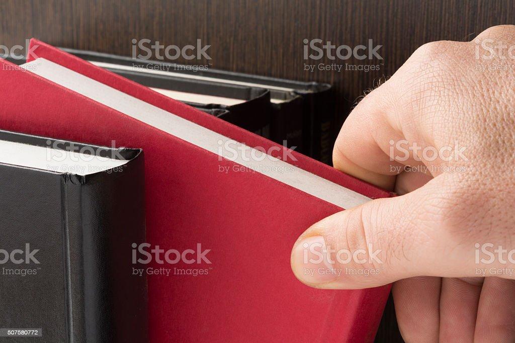 Taking a book stock photo