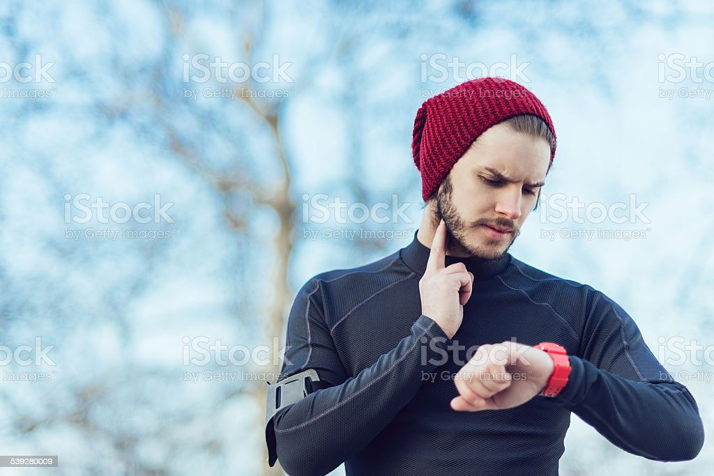 taking a break and checking pulse stock photo