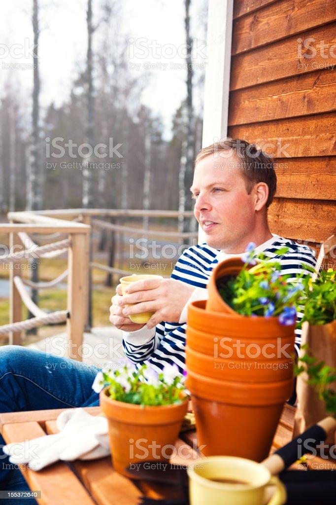 Taking a break from gardening royalty-free stock photo