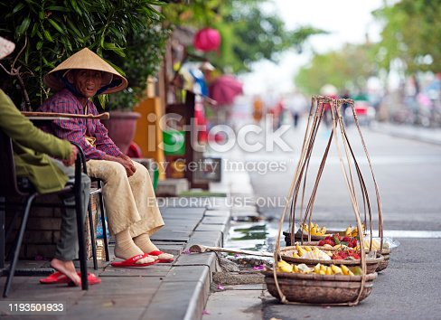 Street scene, Hoi An, Central Vietnam. Hội An, a former port city known for the well-preserved Ancient Town, known for its canals and architecture, a mix of eras and styles from colourful French colonial buildings, wooden Chinese shophouses, temples, ornate Vietnamese tube houses and Japanese Covered Bridge with its pagoda -  central coast, Vietnam