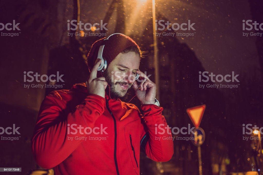 taking a break from workout and enjoying the music stock photo