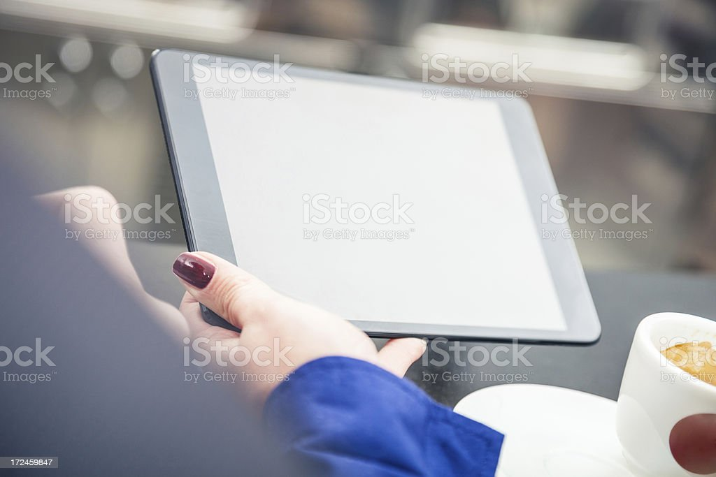 Taking a break reading news on tablet royalty-free stock photo