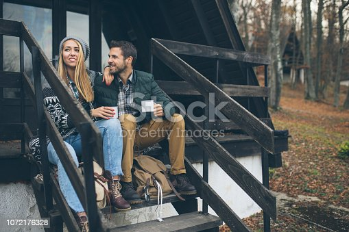 Cute Couple taking a break with hot drink