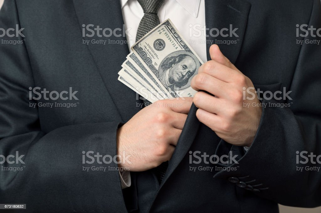 Taking a bribe stock photo