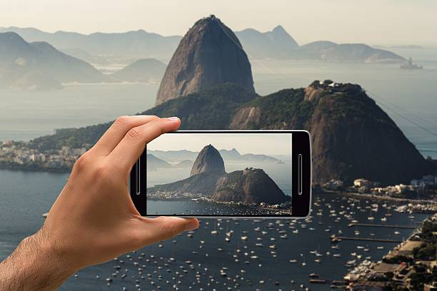 Taking a cellphone photo of Sugarloaf, Brazil stock photo