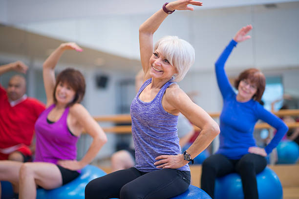 Taking a Fitness Class at the Gym stock photo
