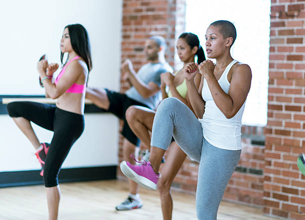taking a kickboxing class - aerobics stock photos and pictures