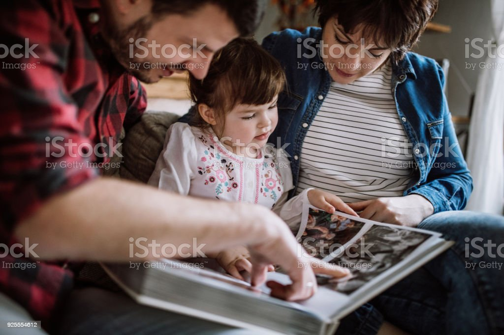 Taking a look at some old family photos stock photo