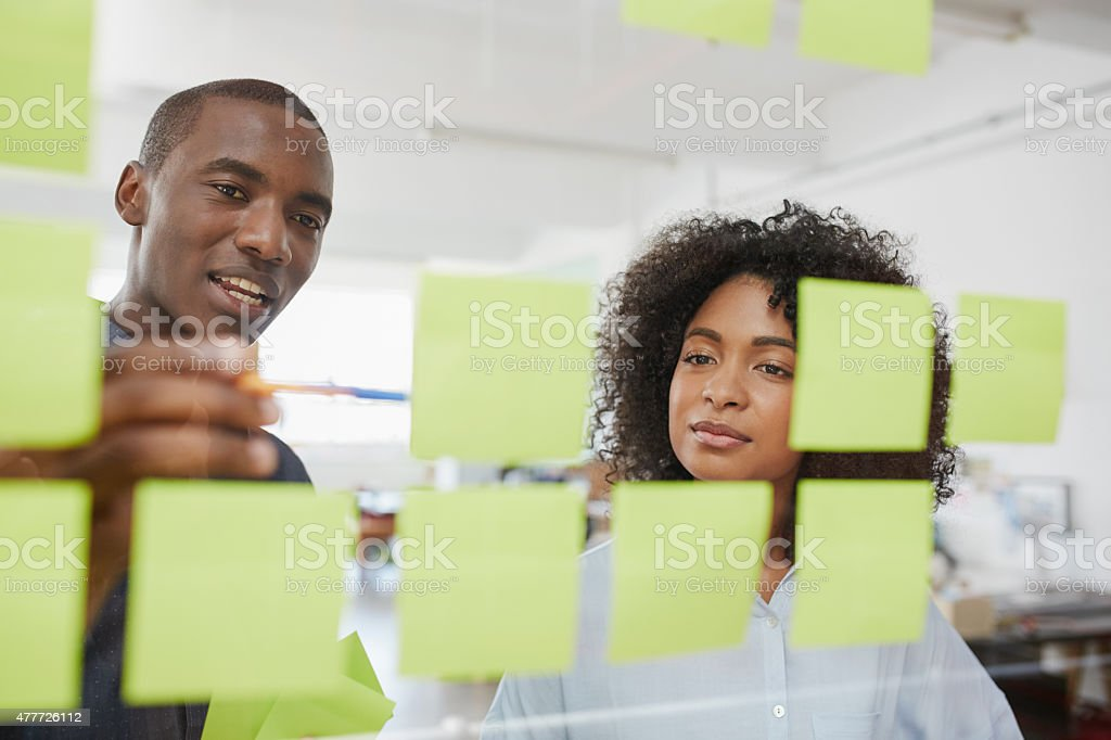 Taking a look at the idea board stock photo