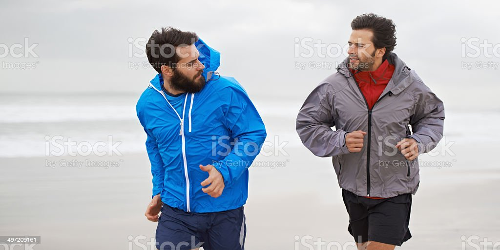 Taking a morning run on the beach stock photo