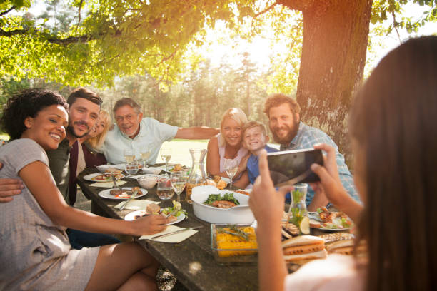 Taking a photo of a big family. stock photo