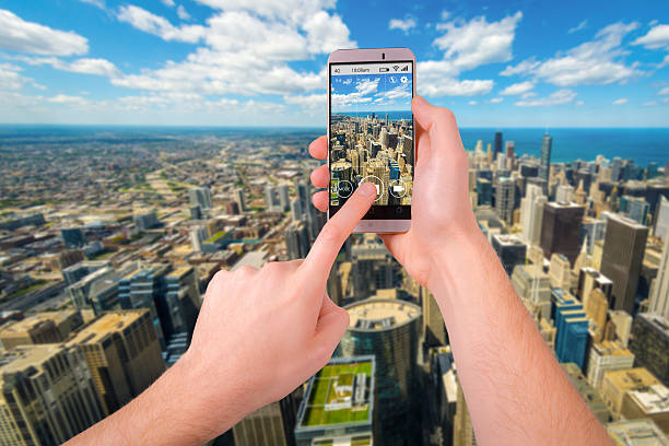 Taking a photo of Chicago skyline with a smartphone stock photo