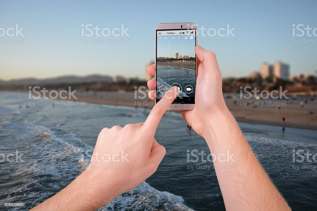Taking a photo of Los Angeles with a smartphone stock photo