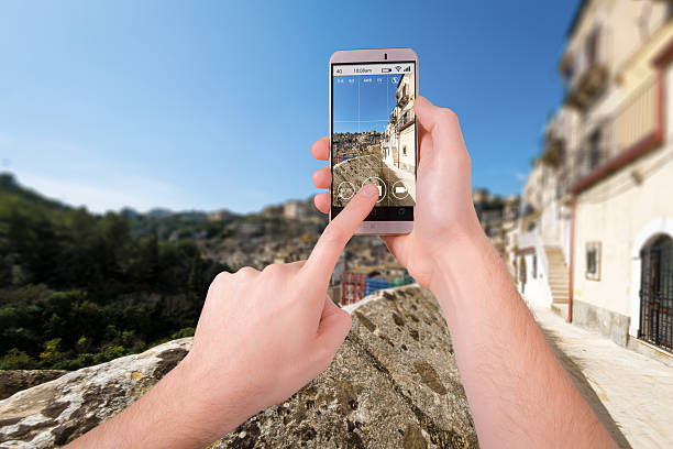 Taking a photo of Ragusa with a smartphone stock photo