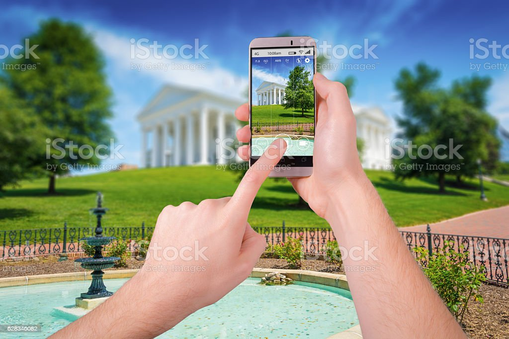 Taking a photo of Richmond State Capitol with a smartphone stock photo
