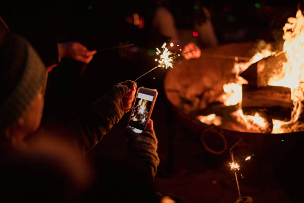 taking a photo of sparklers - falò foto e immagini stock